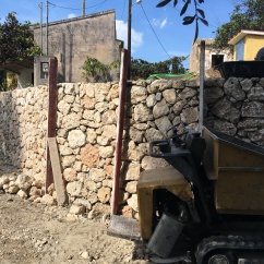 Stone wall under construction