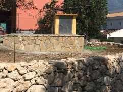 crazy paving and stone wall